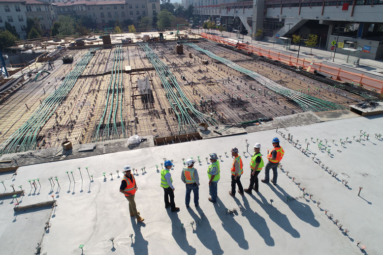 Construction site, people with hard hats and protective jackets
