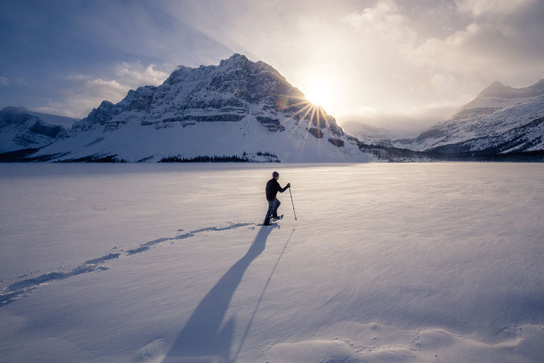 Things to do in Banff in Winter - Snowshoeing across Bow Lake towards Bow Falls