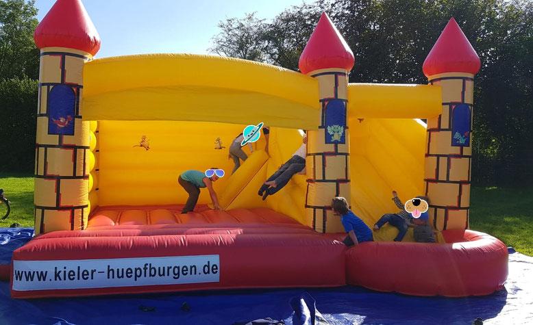 Bouncer mit Rutsche Springburg Hüpfkissen Rutschschloss Bounce mit Rutsche und Haus in Kiel mieten