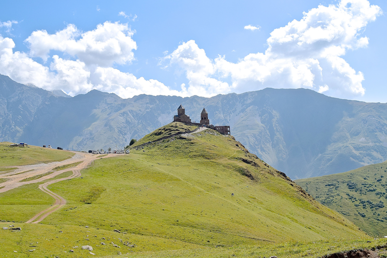 10 Scenic Hikes Around the World - The Gergeti Church in Stepantsminda
