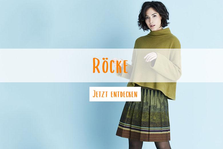 Frau mit grünem Pullover und einem Rock gemustert in Grüntöne