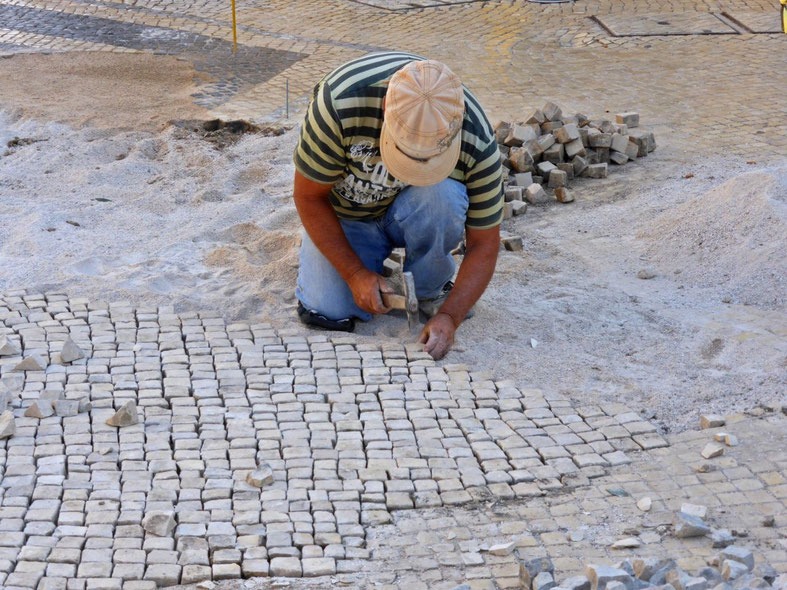 Craftsman repairing the pavement