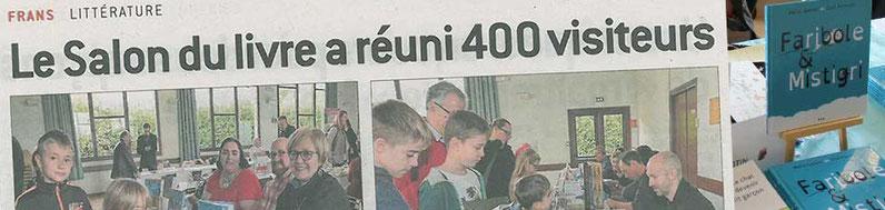 Cloé Perrotin en photo dans l'article du journal Le Progrès pour fêter les 400 visiteurs du Salon du Livre de Frans 2016