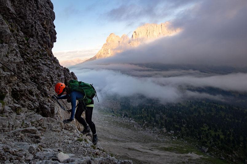 Climber on the via ferrata Pössnecker with Sassolungo mountain in the background