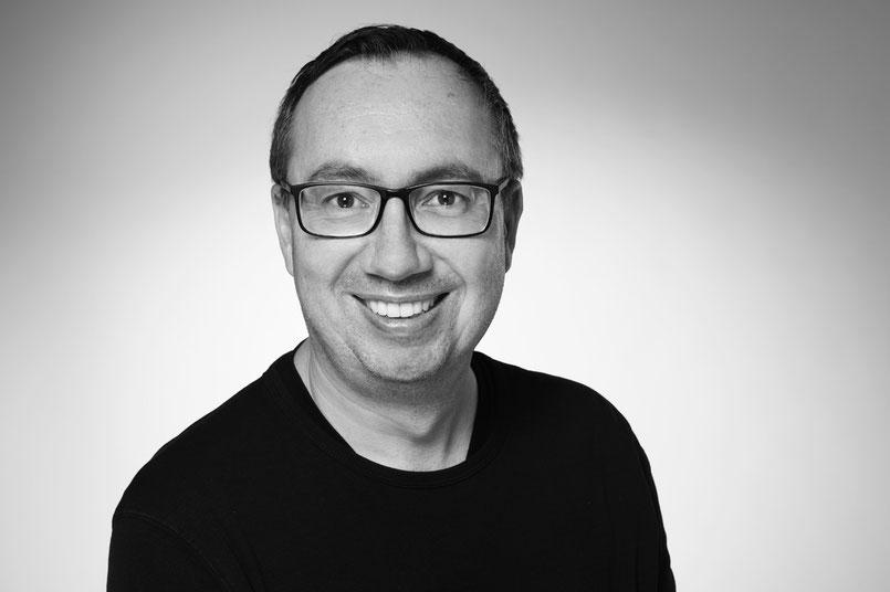 Portraitfoto von Dr. Ralf Winnen