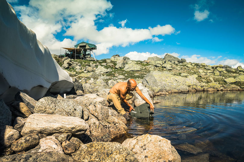 Filling up the Lifesaver Jerrycan with glacial water, like a true overlander.