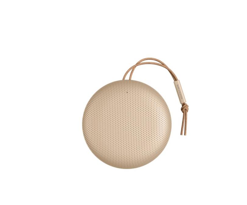 Der runde Lautsprecher in Gold.