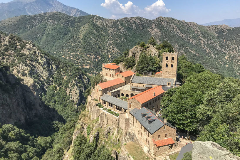 Abbaye Saint-Martin-du-Canigou surrounded by beautiful forests and mountains.