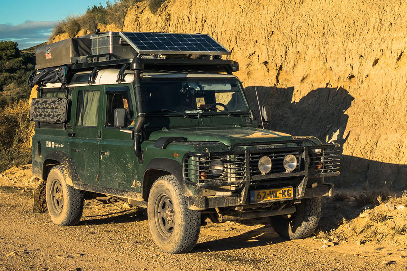 Tembo roof rack on our overland travel Land Rover Defender with solar panel and rooftent