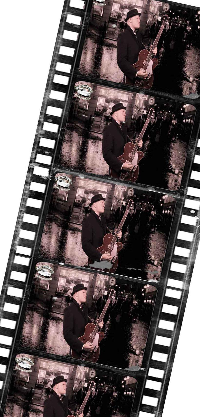 English teacher ZakWashington (alias Miki Pannell) playing guitar in a Soho street, London