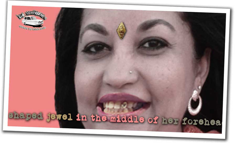 British culture: photo of an Indian woman with a jewel in her forehead and a gold tooth.
