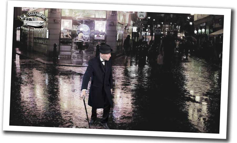 ZakWashington, English teacher, stood in a rainy street in Soho (still from Learn English with ZakWashington video)