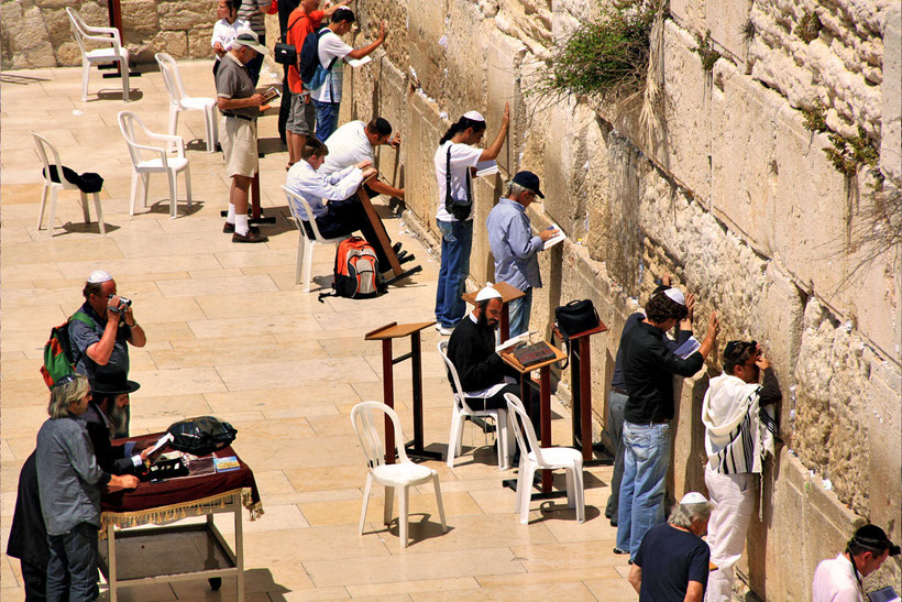 People praying at the Western Wall, Jerusalem, Israel © Sabrina Iovino | JustOneWayTicket.com