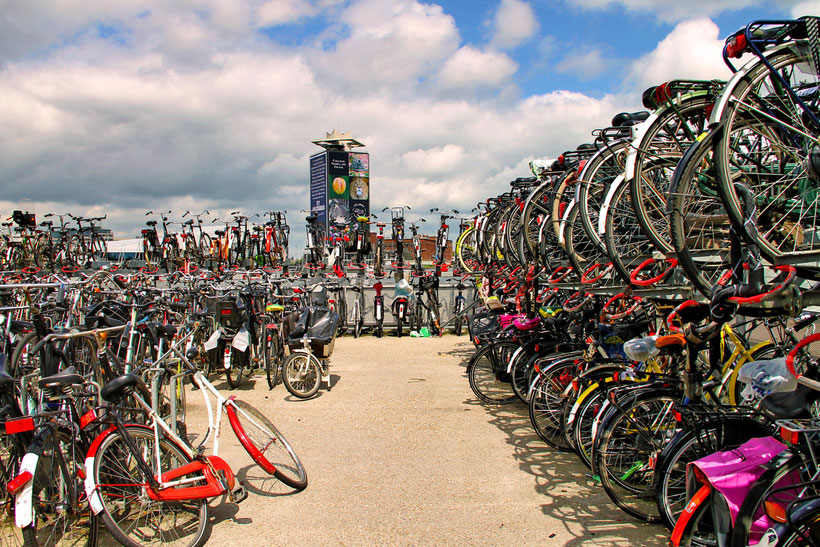 A few bikes, next to Central Station in Amsterdam, The Netherlands 2013 © Sabrina Iovino | JustOneWayTicket.com