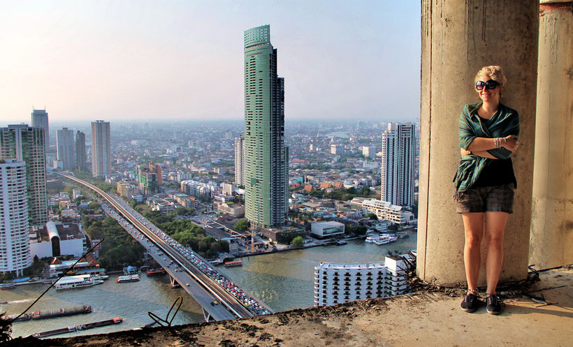 View over the river from the Sathorn Unique Building, Bangkok, Thailand. © Sabrina Iovino | JustOneWayTicket.com