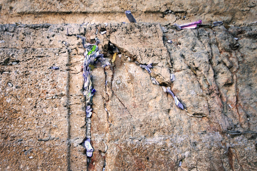 Every crack was filled with prayers. The Western Wall, Jerusalem, Israel © Sabrina Iovino | JustOneWayTicket.com