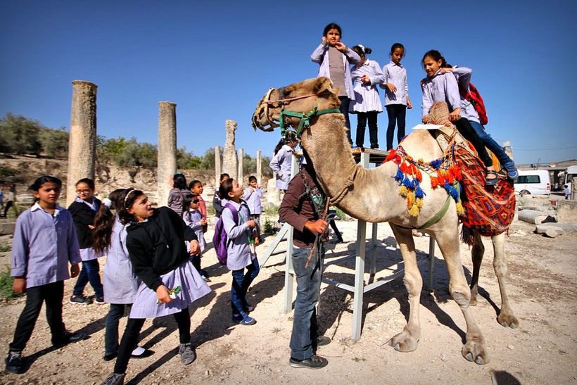 Shortly after the girls were offered to ride a camel, so eventually they lost any interest on taking more images with me. It's OK. © Sabrina Iovino | JustOneWayTicket.com