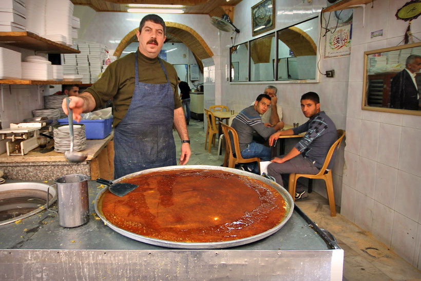 Knafeh (also spelled as Kanafeh or Kunafeh) is a delicious cheese pastry, soaked in sugar-based syrup with melted goat cheese on top. © Sabrina Iovino | JustOneWayTicket.com