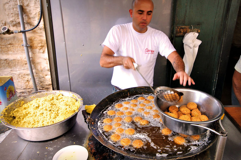 Lunch time in Bethlehem, Arab Style. Hot Falafel at Afteem Restaurant. © Sabrina Iovino | JustOneWayTicket.com