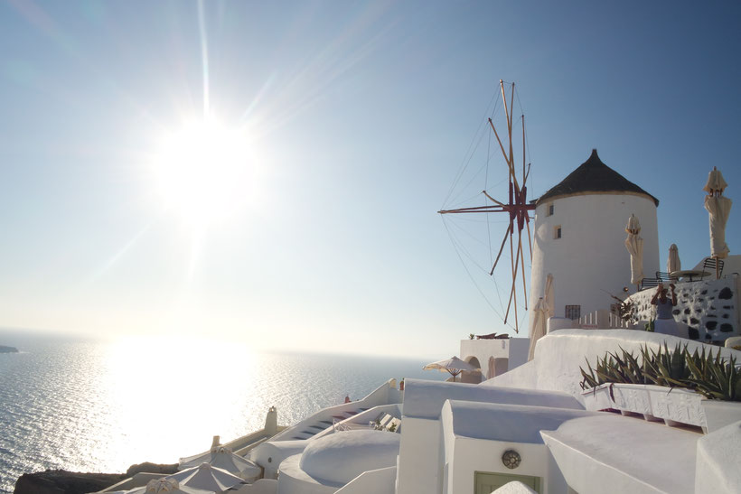 Sunset on Santorini with windmill
