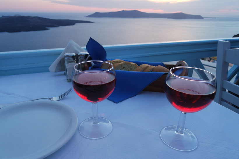 sunset dinner on Santorini Fira wine glasses