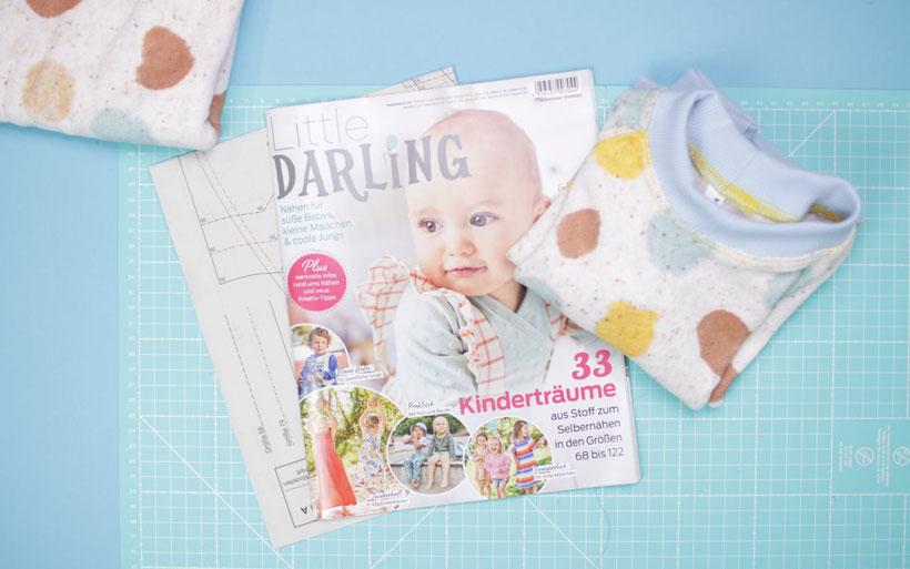 [Werbung] Baby Sweatshirt mit Raglanärmeln nähen: Aus der neuen Little Darling Kollegtion - Pullover für Babys aus Frotteestoff mit Bündchen. Videanleitung perfekt für Nähanfänger. Nähanleitung von DIY Eule. Nähen für Babys.