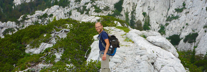 Hiking the Premužić path, on a karst rock formation in the Northern Velebit National Park