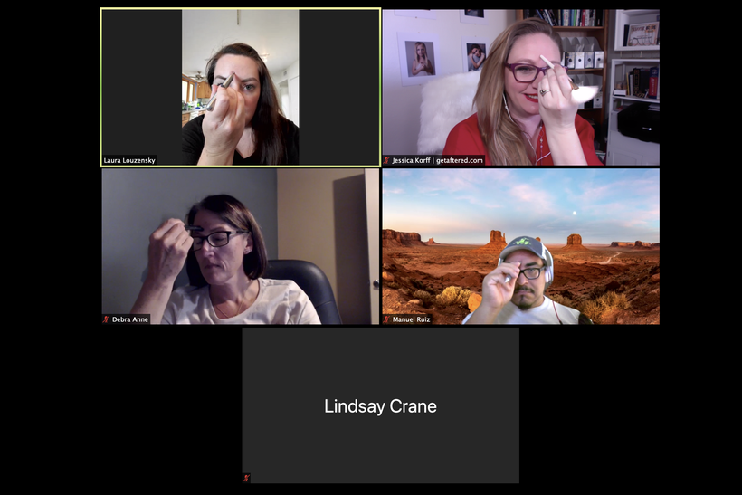 Screenshot of zoom live participants using facial reflexology to reduce stress and tension in forehead.