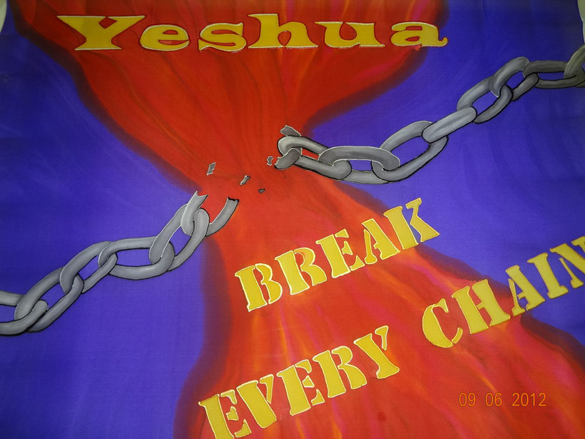 """Large grey chain across a deep blue background.  Red flows down from """"Yeshua"""" in gold, where it shatteres the chain.  """"Break Every Chain"""" across the bottom of flag."""