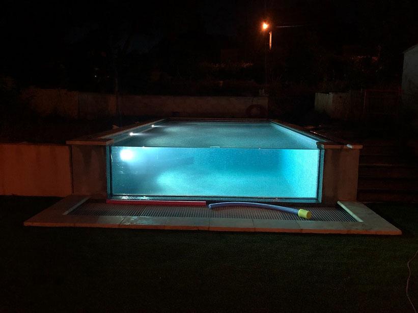 éclairage piscine en verre