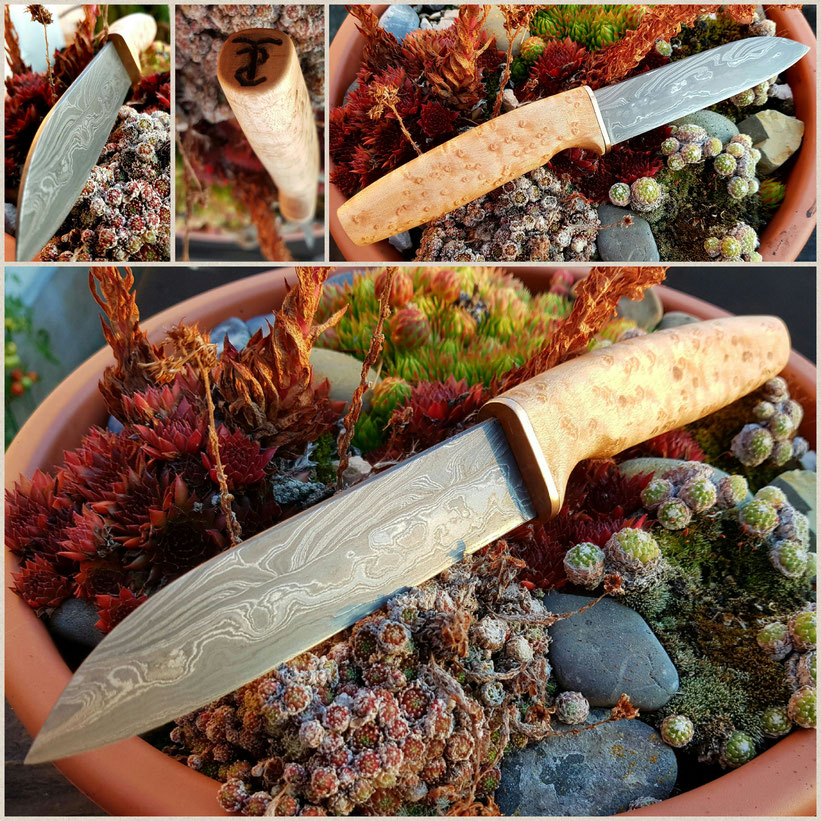 Ein von Hand geschmiedetes Jagdmesser aus 272 Lagen Damast mit einem Griff aus Augenahorn. Reine Handarbeit aus der Telchinen-Schmiede.