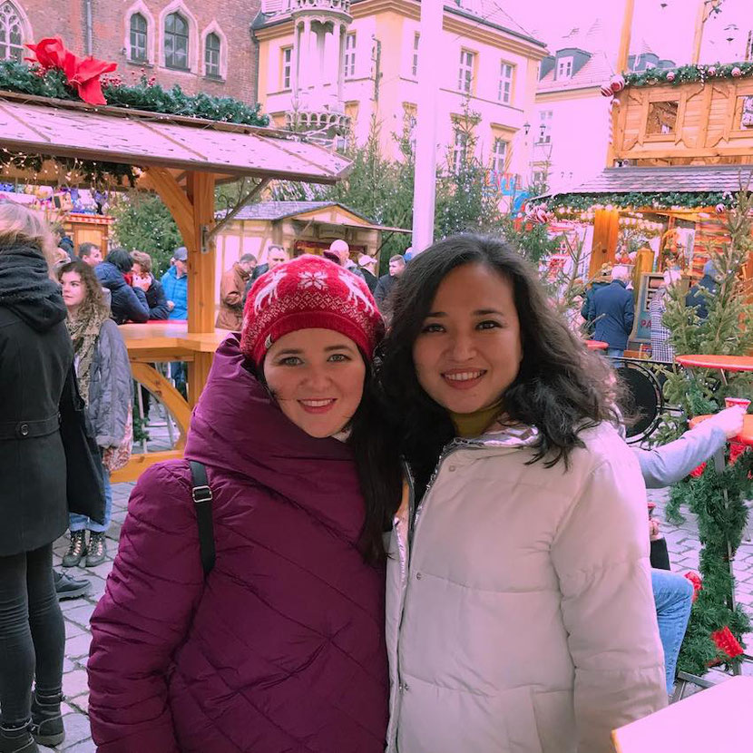 Me and my travel friend Irina at the Christmas market in Wroclaw, Poland