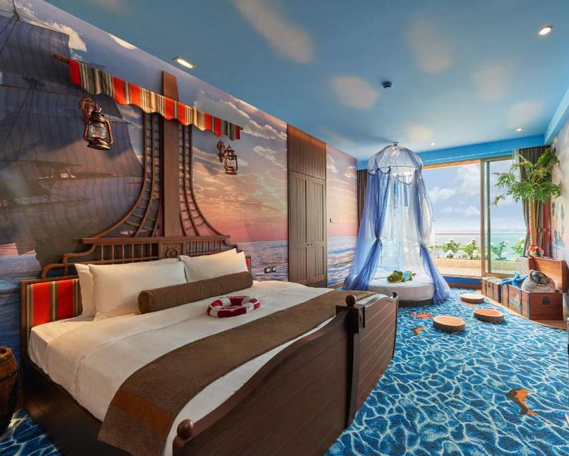 themed room looking like an adventure movie with a pirate ship and treasures in an unusual hotel in Hong Kong