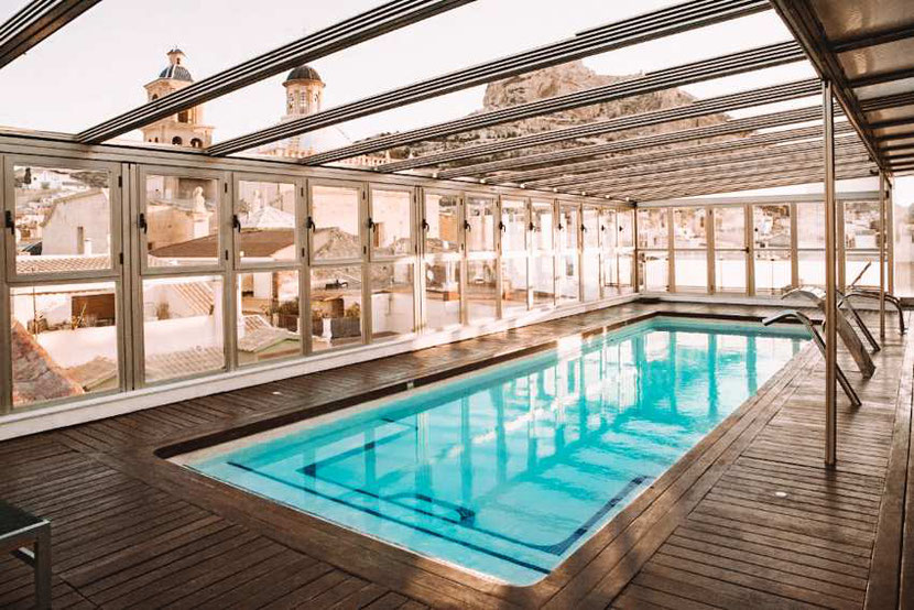 a rooftop swimming pool in a unique hotel in Alicante Hospes Amerigo
