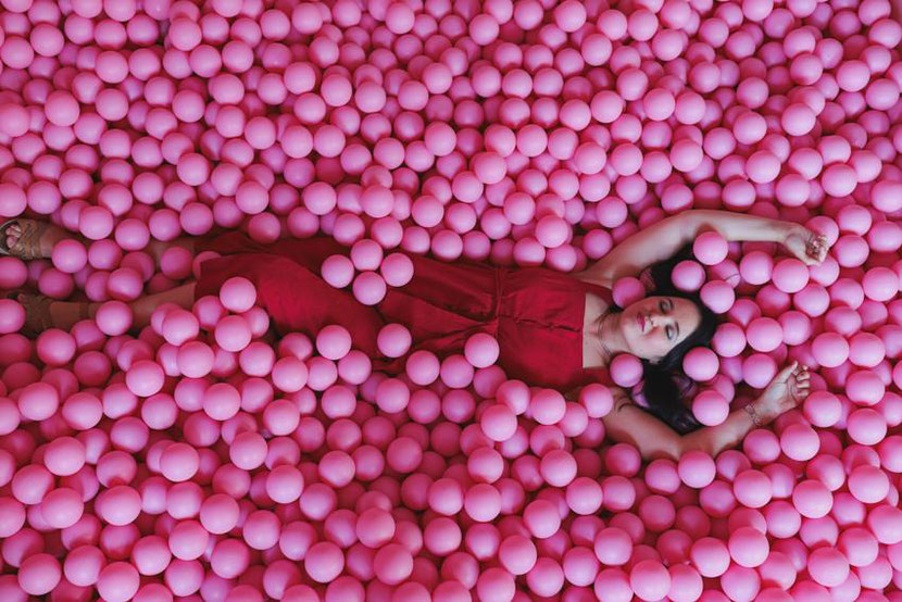 Unusual and fun things to do in Krakow, Poland. In this photo I am in a  ball pool at the bar Bubble Toast