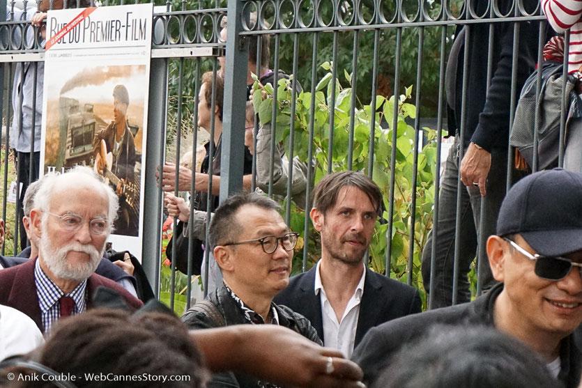 Wong Kar-wai et Nicolas Sedoux, lors du tournage du remake de la Sortie des Usines Lumière - Festival Lumière 2017 -  Lyon - Photo © Anik Couble
