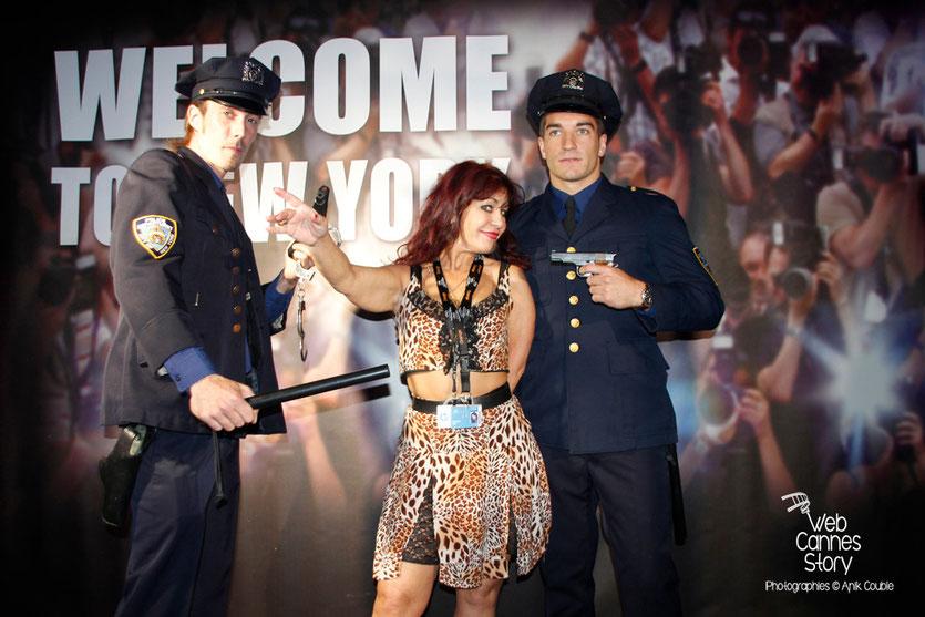 Esméralda Petit-Benito, une des célèbres femmes panthères, encadrée par 2 policiers newyorkais, lors de la soirée du Film « Welcome to New York » d'Abel Ferrara - Festival de Cannes 2014 - Photo © Anik COUBLE