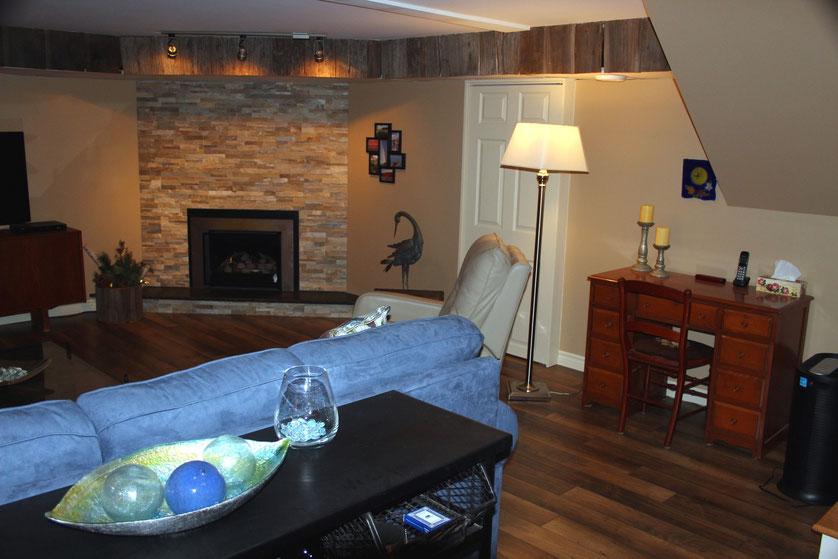 Finished Basement Renovation - Fireplace, furniture, flooring, etc