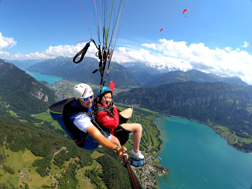 Interlaken Paragliding capital of the world lakes snowcapped Mountains
