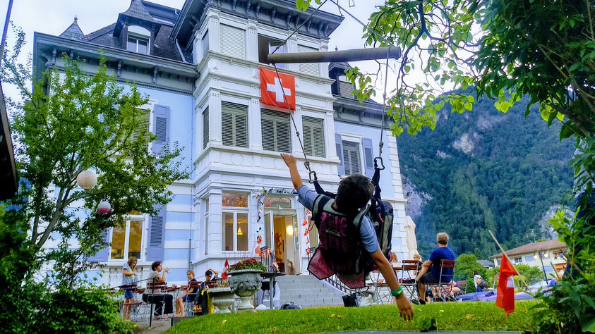 paragliding harness swing during a summer bbq at the Adventure Hostel Interlaken