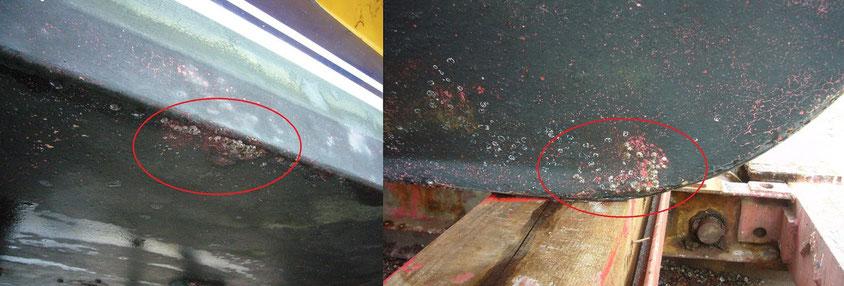 前の塗装が出てきた部分。この塗料(赤)で塗っていたら全面フジツボ付着か?