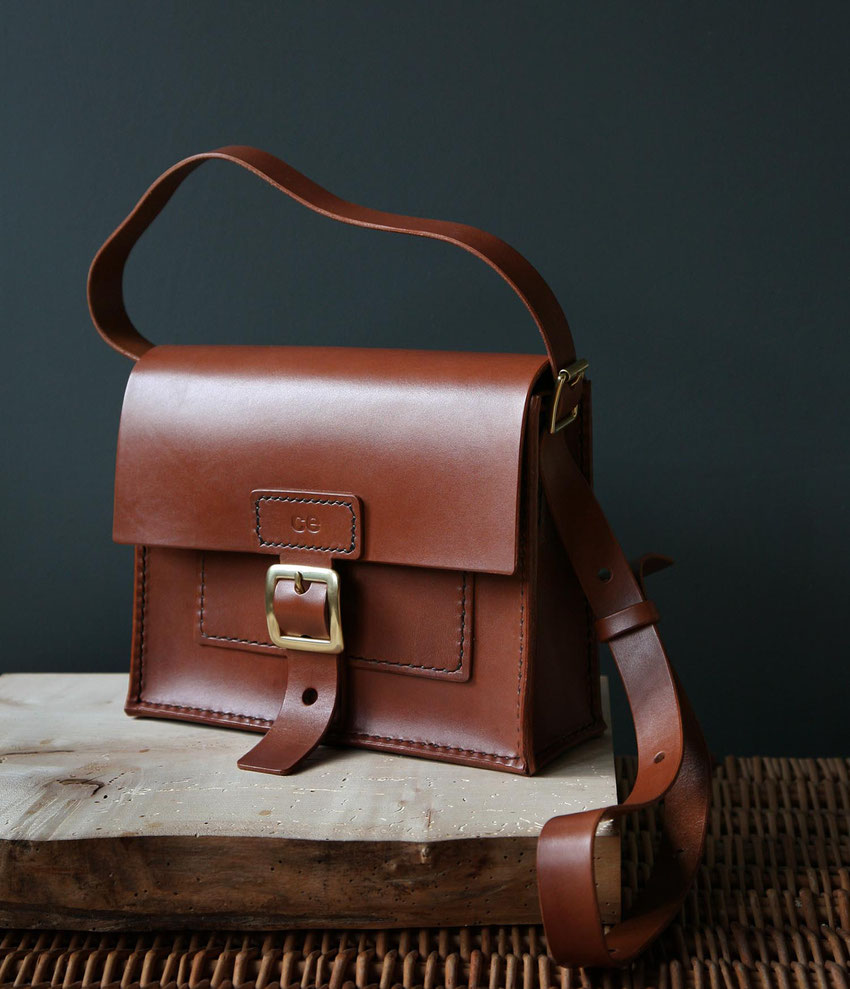 small tiny compact neat luxury leather satchel
