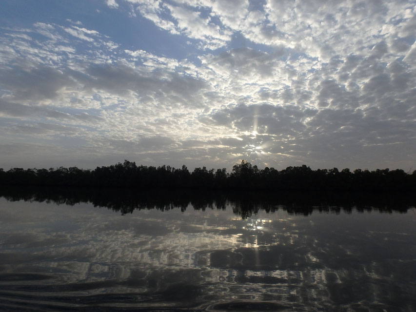 sunrise and reflections, Tumani Tenda