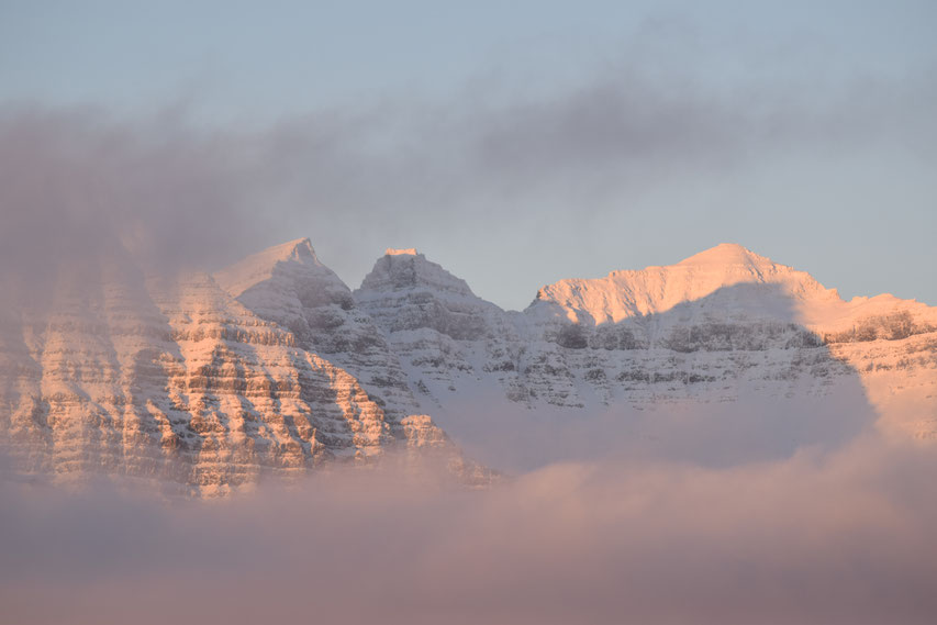 Mountains in cloud at sunrise, East Fjords, Iceland
