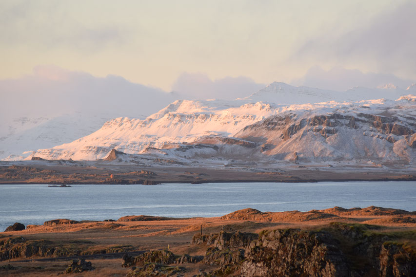 Sunrise on snow across the sea, East Fjords, Iceland