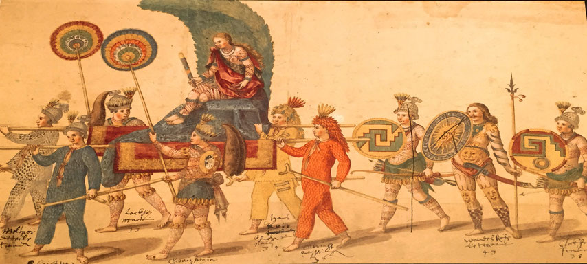 """Der württembergische Herzog Friedrich I. als """"Königin Amerika"""" auf einem Fastnachtsumzug. Mit dabei zwei aztekische Federschilde."""