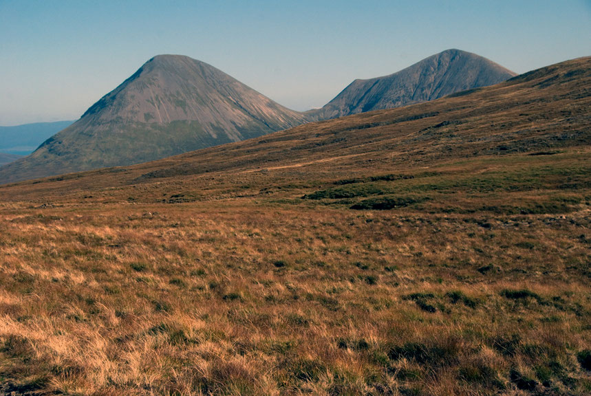 The Red Hills (Glamaig 775m and Beinn Dearg Mhor 731m) adjacent to the Cuilleans on Skye. These were formed by granitic intrusions and have left a very different form of mountain after glaciation.