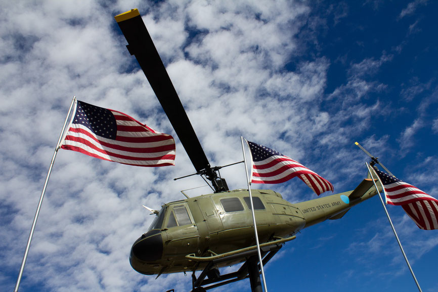 patriotic picture of a helicopter huey passing behind usa flags america murica great photography to buy