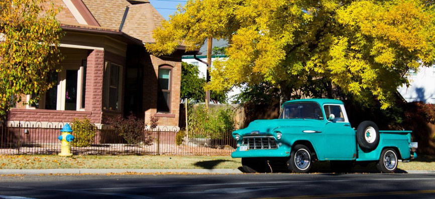 classic suburb art photography to buy showing a turquoise vintaje pick up truck from the fifties in front of a suburban house