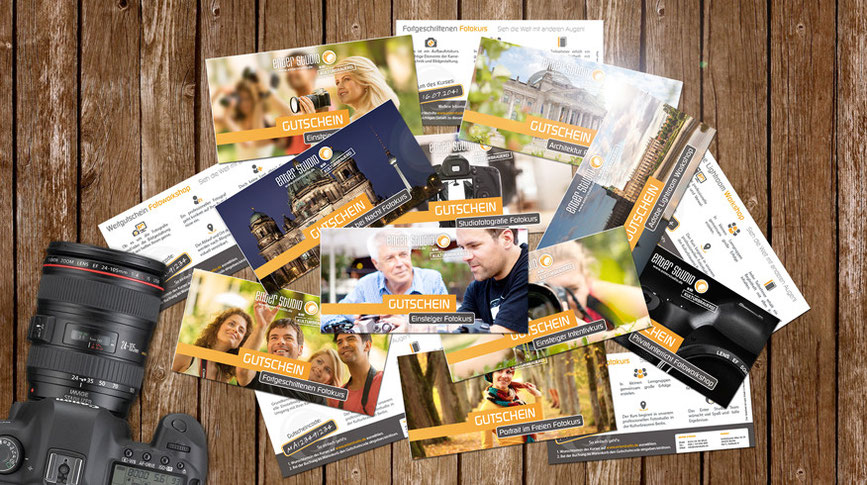 Gutscheine für Fotokurse und Fotoworkshops Stapel Kamera